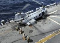 U.S. Marines board a CH 46 Sea Knight helicopter o