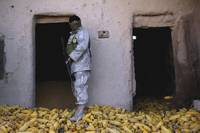 An Iraqi army soldier checks a storage room during