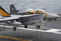 n F/A-18F Super Hornet lands aboard the aircraft c