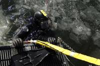 US Navy Diver gets ready to start his dive off the