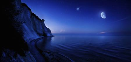 Moon rising over tranquil sea and Mons Klint cliff