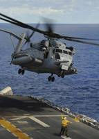 A CH 53E Sea Stallion helicopter takes off from am