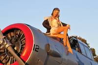 1940's style aviator pin-up girl posing with a vi