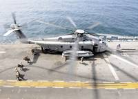 U.S. Marines board an MH 53E Sea Dragon helicopter