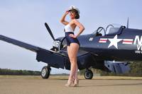 1940's style Navy pin-up girl posing with a vinta