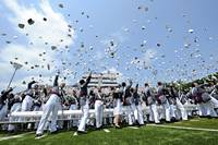 Cadets toss their hats at the end of graduation
