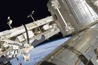 Astronaut participates in extravehicular activity