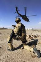 A soldier conducts security for an HH60 Pavehawk h