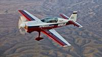 Extra 300 aerobatic aircraft over Mesa, Arizona