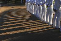 Sailors stand at parade rest during a ceremony