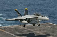 An F/A-18F Super Hornet prepares to land aboard US