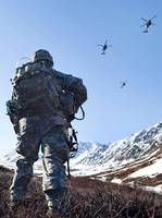 Soldier patrols through Alaska's Chugach Range as