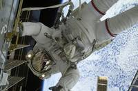 Astronaut participates in a session of extravehicu