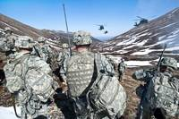 Soldiers wait for UH-60 Black Hawk helicopters to