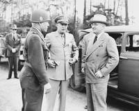 President Harry Truman talking to Generals Eisenho