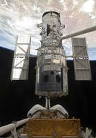 The Hubble Space Telescope is released from the ca