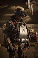 U.S. Navy Seal equipped with night vision prepares