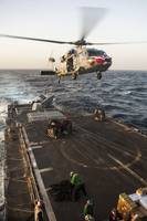 An MH-60S Sea Hawk helicopter delivers cargo to US