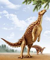 A Scelidosaurus standing on its hind legs eating c