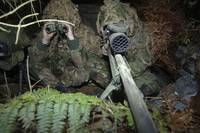 A British Army sniper team dressed in ghillie suit