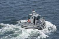 Navy working boat moves back to its mooring