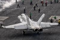 A US Navy F/A-18C Hornet on the flight deck of air