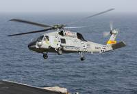 A SH-60J Seahawk during a vertical replenishment i