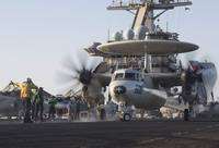 An E-2C Hawkeye during flight operations on USS Dw