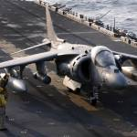 """Sailors prepare an AV-8B Harrier jet aircraft for"" by stocktrekimages"