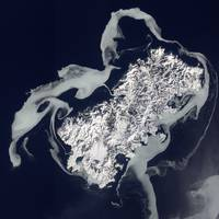 Sea ice surrounds the volcanic island of Shikotan