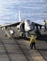 Sailors prepare to launch an AV-8B Harrier during