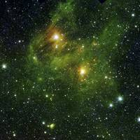 Two extremely bright stars illuminate a greenish m