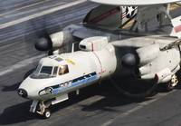 An E-2C Hawkeye sits ready aboard USS Harry S. Tru