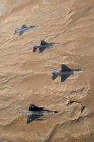 Military fighter jets fly in formation over Jordan