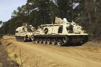 An M88 recovery vehicle begins to tow an M992 fiel