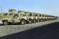 Mine Resistant Ambush Protected vehicles sit at Ca