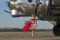 Beautiful 1940's style pin-up girl standing in fr