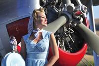 Close-up of a 1940's style pin-up girl in front o