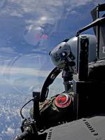 An F-15 Eagle pilot flies in formation with his wi