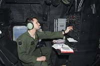 Airman at work as Radio Operator in an MC-130P Com