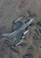 An F-16 Fighting Falcon on a training mission over