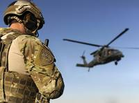 A pararescueman awaits the landing of an HH-60 Pav