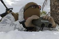A scout sniper watches to see any position changes