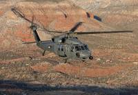 An HH-60G Pave Hawk flies a low level route over N