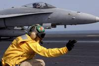 A shooter launches an F/A-18E Super Hornet from US