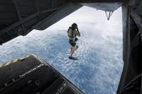 Air Force pararescueman jumps from a CH-53E Super