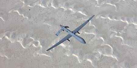 An MQ-1 Predator flies over the White Sands Nation