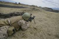 A U.S. Marine provides suppressive fire during a s