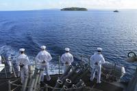 Sailors man the rails aboard guided-missile destro