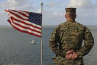 A soldier stands at attention on USS Bonhomme Rich